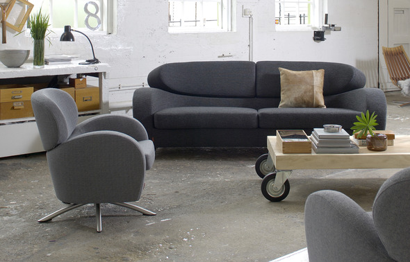 STREAM 3- seat sofa in textile Ere charcoal. STING chair in textile Sara grey.